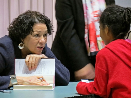 1-30-13-Justice-Sonia-Sotomayor-talking-to-young-girl